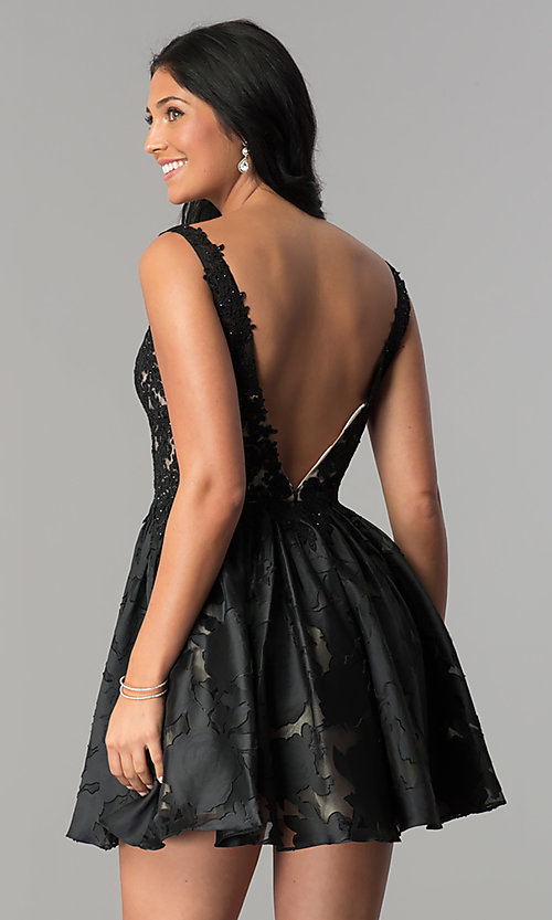 Image of open-back black v-neck short homecoming party dress. Style: TI-GL-1725H4802 Back Image