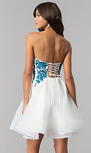 Image of ivory homecoming dress with corset and blue lace. Style: TI-GL-1721H4518 Back Image