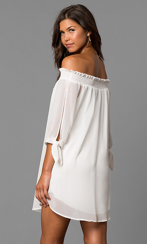 Image of short shift homecoming party dress in eggshell white. Style: CT-9560RU9B Back Image
