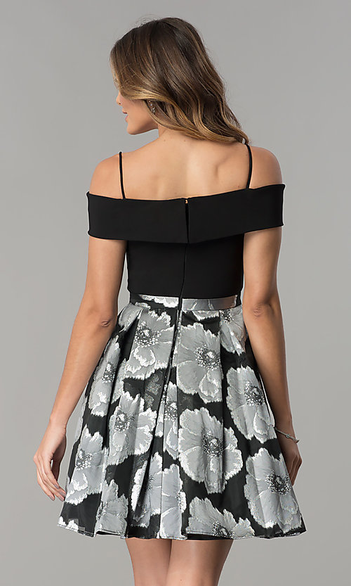 Image of off-the-shoulder short black/silver print party dress. Style: MO-12426 Back Image