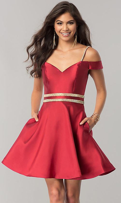 Image of JVNX by Jovani wine red off-shoulder homecoming dress. Style: JO-JVNX57265 Front Image