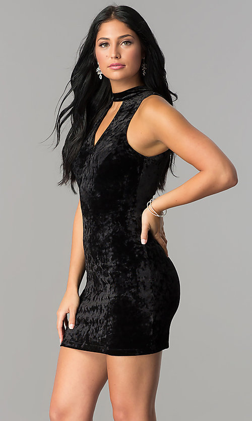 Image of short velvet black party dress with cut outs. Style: SS-D68931DVD Detail Image 1