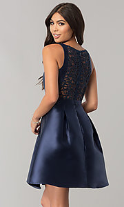 Image of navy blue homecoming dress with embroidered back.  Style: MT-8521 Back Image