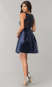 Image of navy blue homecoming dress with embroidered back.  Style: MT-8521 Detail Image 2