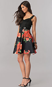 Image of short black satin party dress with print skirt. Style: MCR-2431 Detail Image 1