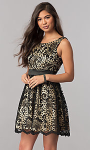 Image of short black lace homecoming dress with nude lining. Style: MCR-1523 Front Image