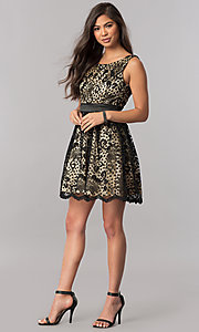 Image of short black lace homecoming dress with nude lining. Style: MCR-1523 Detail Image 1