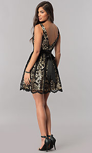 Image of short black lace homecoming dress with nude lining. Style: MCR-1523 Detail Image 2