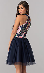 Image of short navy blue homecoming dress with floral bodice. Style: MCR-2437 Back Image