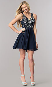 Image of navy blue short v-neck homecoming dress with cut outs. Style: DQ-2124 Detail Image 1