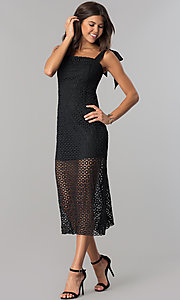 Image of midi-length black lace party dress with short slip. Style: JTM-JMD7667 Front Image