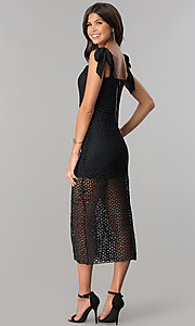 Image of midi-length black lace party dress with short slip. Style: JTM-JMD7667 Back Image