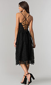 Image of midi-length black v-neck lace party dress. Style: JTM-JMD7748 Back Image