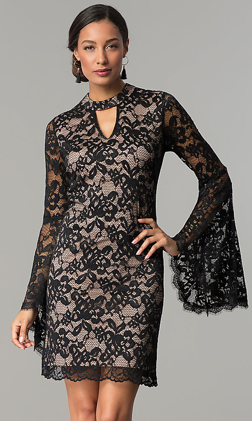 Image of black and nude short lace party dress with sleeves. Style: JX-1ZBK295Q Front Image