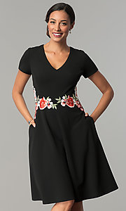 Image of knee-length black casual party dress with pockets. Style: SG-SBBY1483 Front Image