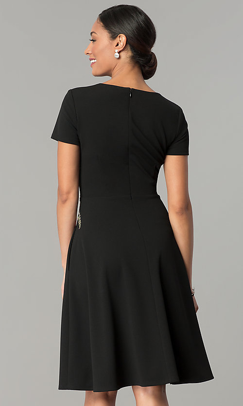 Image of knee-length black casual party dress with pockets. Style: SG-SBBY1483 Back Image