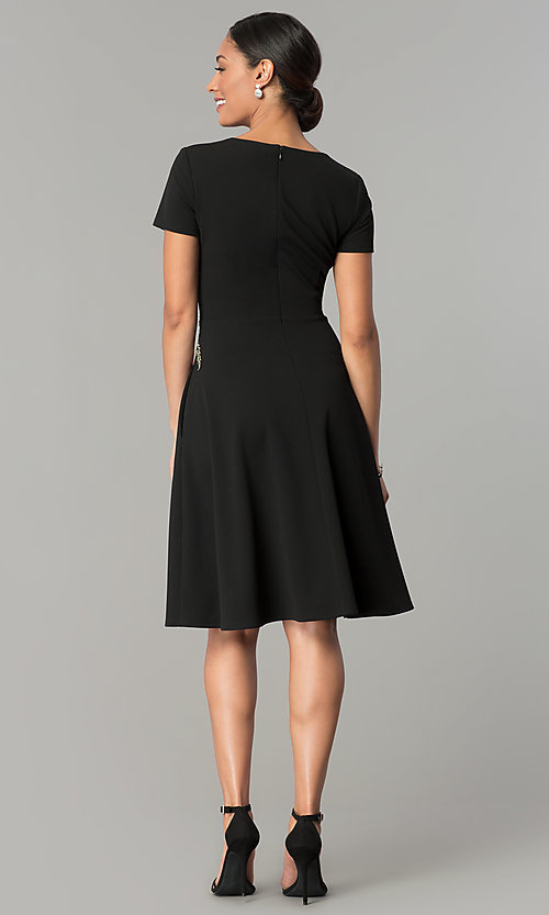 Image of knee-length black casual party dress with pockets. Style: SG-SBBY1483 Detail Image 3