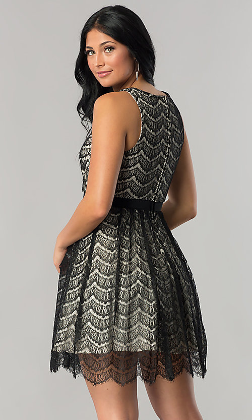 Image of junior-size black lace short party dress. Style: DMO-J316847 Back Image