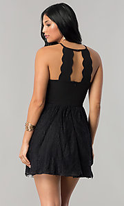 Image of short junior-size black party dress with lace skirt. Style: DMO-J316967 Back Image
