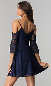 Image of short navy lace casual party dress with bell sleeves. Style: CT-3427ZZ6BT1 Back Image