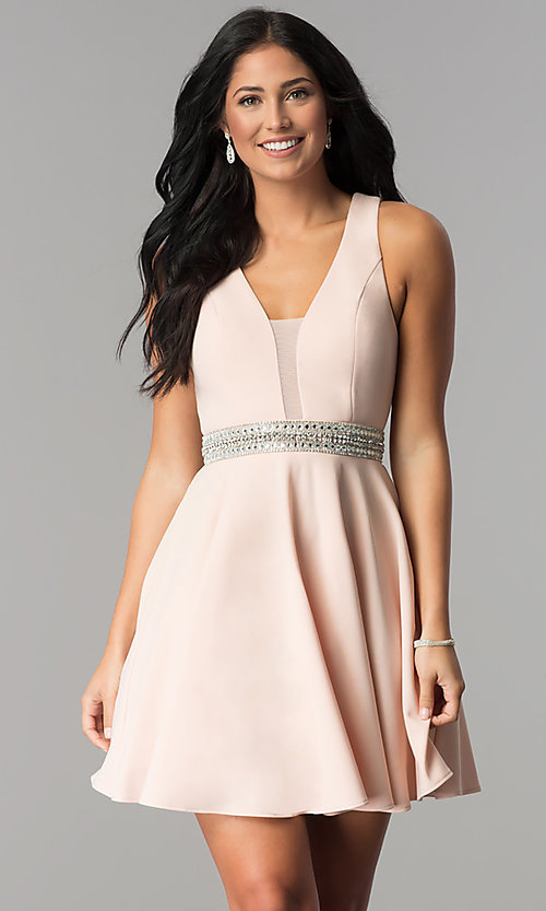 Image of v-neck junior-size short party dress in blush pink. Style: DMO-J318007 Front Image