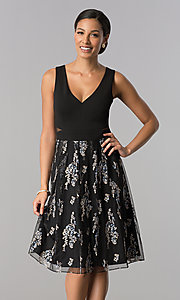 Image of knee-length black party dress with embroidered skirt. Style: SD-S278093 Front Image