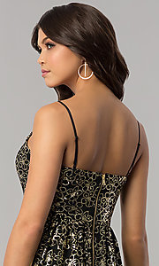Image of short black party dress with gold metallic print. Style: EM-FFN-3201-030 Detail Image 2