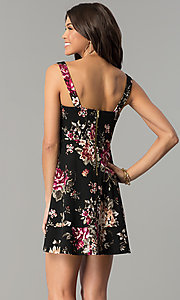 Image of short v-neck floral-print black wedding-guest dress. Style: EM-ENE-3370-001 Back Image