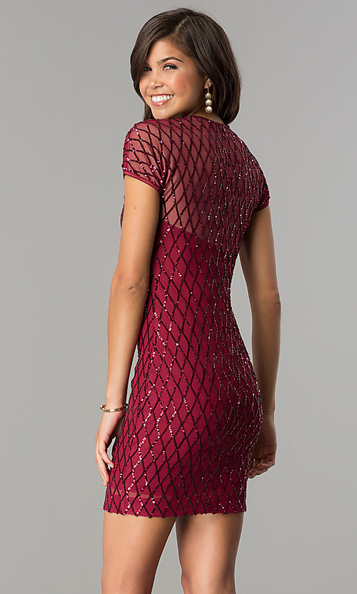 Image of sequin-print short party dress with short sleeves. Style: MCR-2456 Back Image