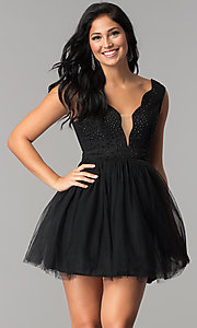 Image of semi-formal short black babydoll homecoming dress. Style: LP-24878 Front Image