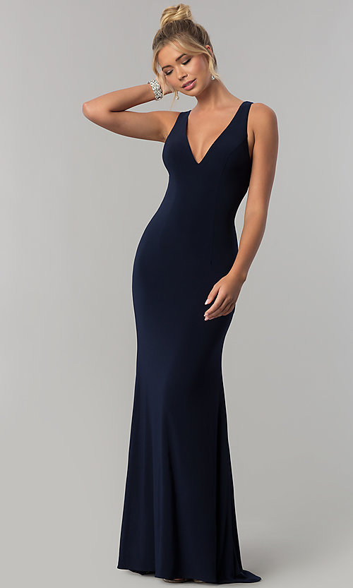 68e5f889700a Image of long navy blue v-neck prom dress with back cut outs. Style