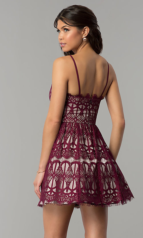 Image of short burgundy red lace party dress with nude lining. Style: DMO-J320387 Back Image