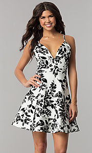 Image of short v-neck ivory party dress with black print. Style: EM-FPT-3451-124 Front Image
