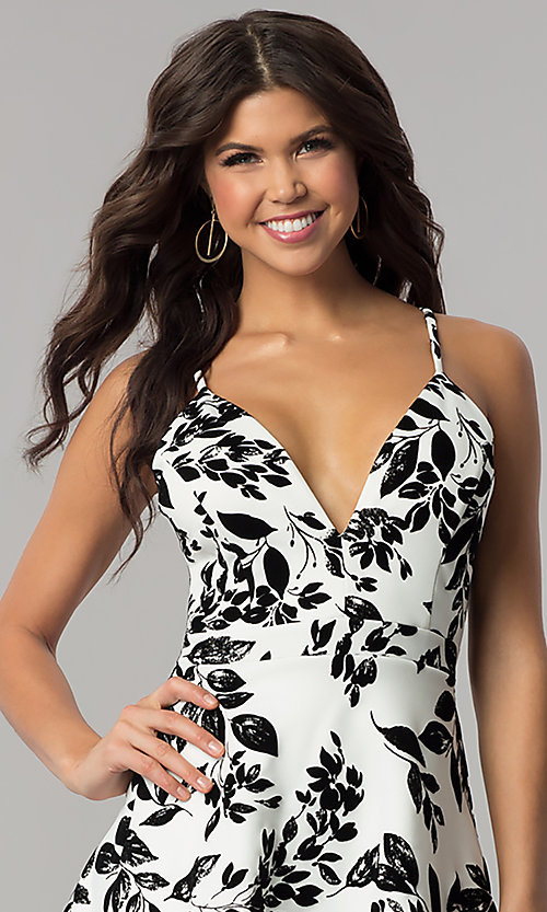 Image of short v-neck ivory party dress with black print. Style: EM-FPT-3451-124 Detail Image 1