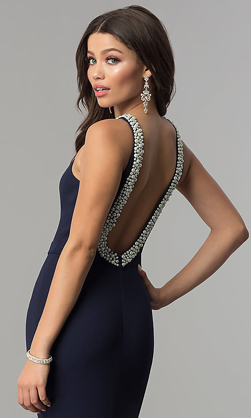 Image of open-back long navy blue prom dress with pearl trim. Style: LP-25043 Detail Image 1