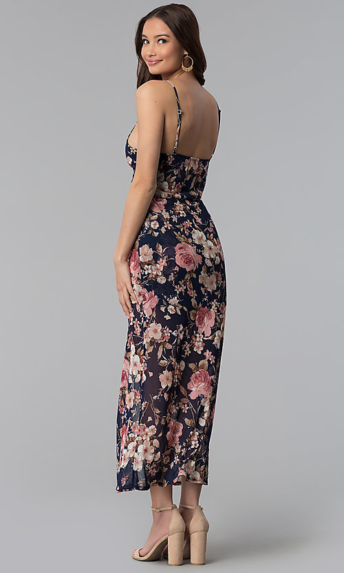 Image of navy and blush floral-print walk-through romper. Style: EM-FSV-3664-425 Back Image