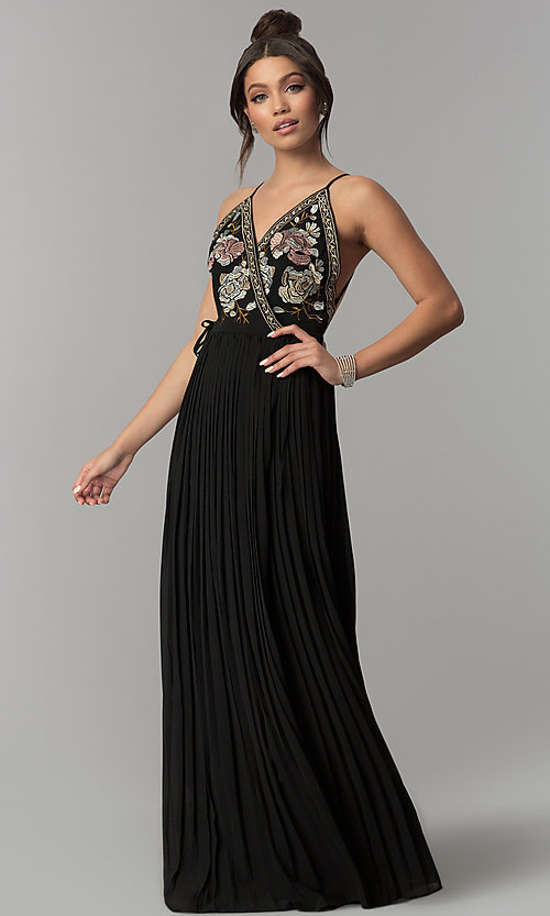Image of long black wrap prom dress with floral embroidery. Style: SOI-M17081 Front Image