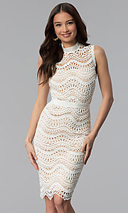 Image of white crocheted-lace knee-length graduation dress. Style: JTM-JMD7752 Front Image