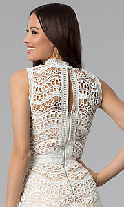 Image of white crocheted-lace knee-length graduation dress. Style: JTM-JMD7752 Detail Image 2