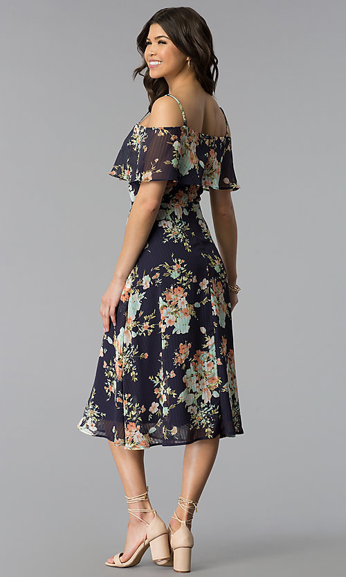 Image of tea-length short print casual Navy party dress. Style: JTM-JD8522 Back Image
