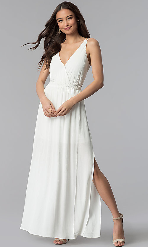Image of long v-neck open-back white maxi graduation dress. Style: RO-R63897 Front Image