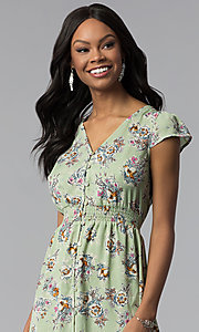 Image of high-low green floral-print wedding-guest dress. Style: AS-A8465d79E69 Detail Image 1