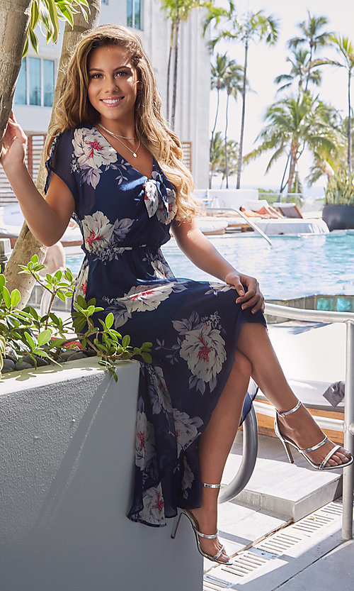 Image of navy blue floral-print high-low casual dress. Style: AS-A877395e34 Front Image