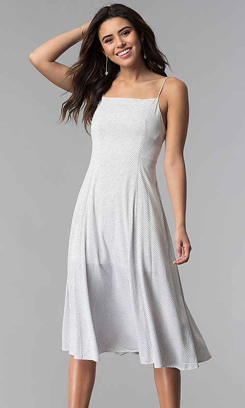 Image of knee-length spaghetti-strap casual party dress. Style: RO-R67680 Front Image