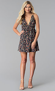 Image of short navy open-back floral-print casual party dress. Style: RO-R67614 Detail Image 3