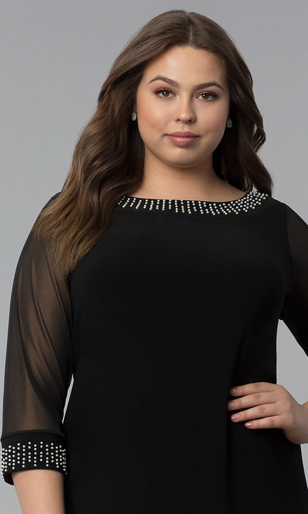 313feaed8f4 ... 3 4-sleeve black plus-size sheath party dress. Tap to expand