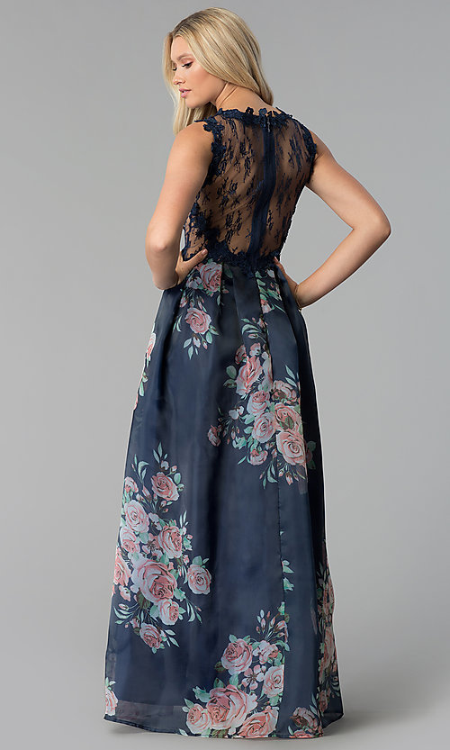 Image of long navy blue prom dress with floral-print skirt. Style: SOI-M17651 Back Image