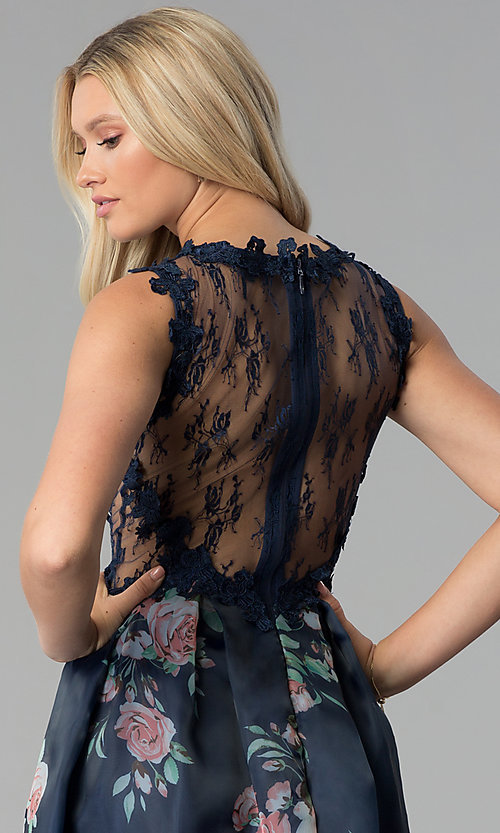 Image of long navy blue prom dress with floral-print skirt. Style: SOI-M17651 Detail Image 2
