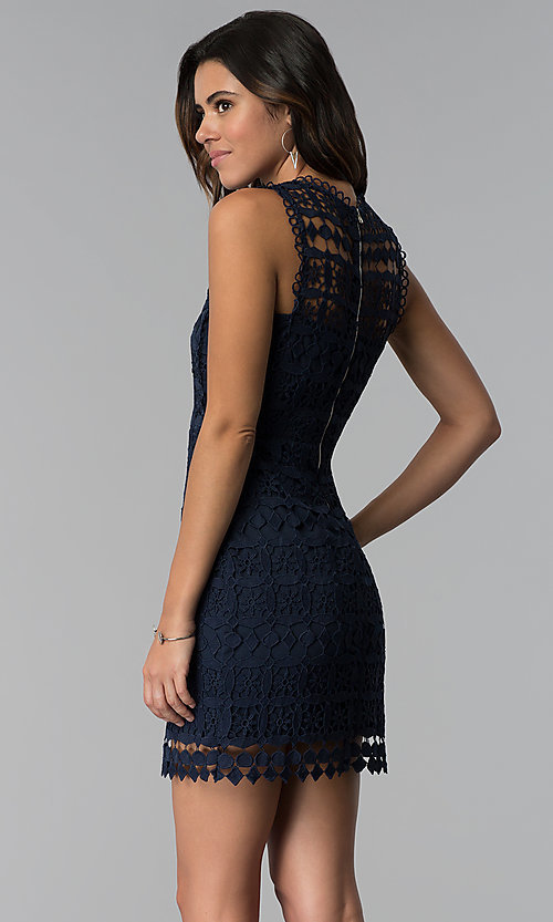 Image of short navy blue crocheted-lace party dress. Style: JTM-JMD8506 Back Image