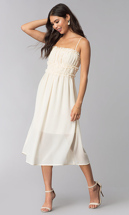 Image of tea-length cream party dress with ruching. Style: ESL-62456D-R Front Image